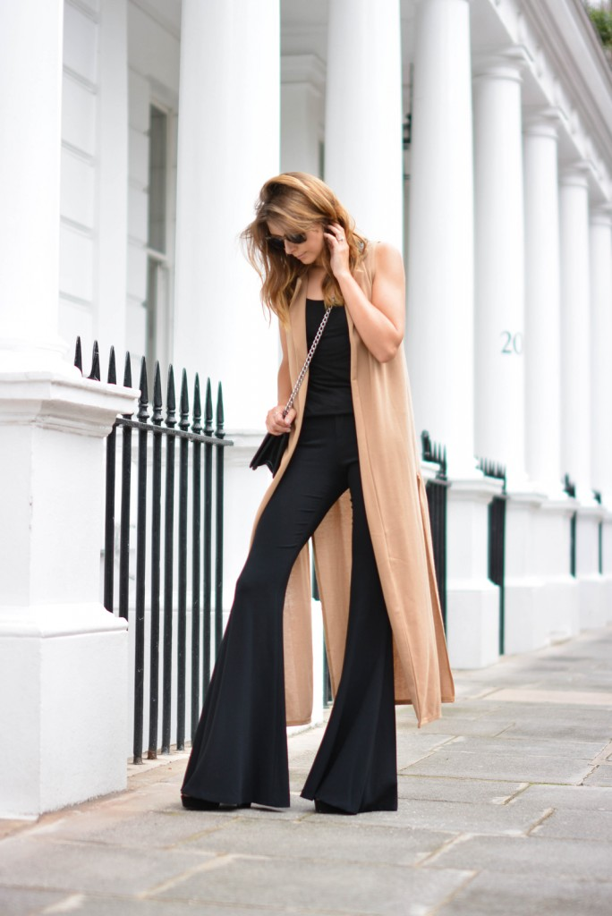 EJSTYLE-wears-black-basic-vest-top-camel-sleeveless-coat-Zara-black-extreme-flares-Black-small-chanel-boy-bag-wood-effect-chunky-sunglasses-684x1024