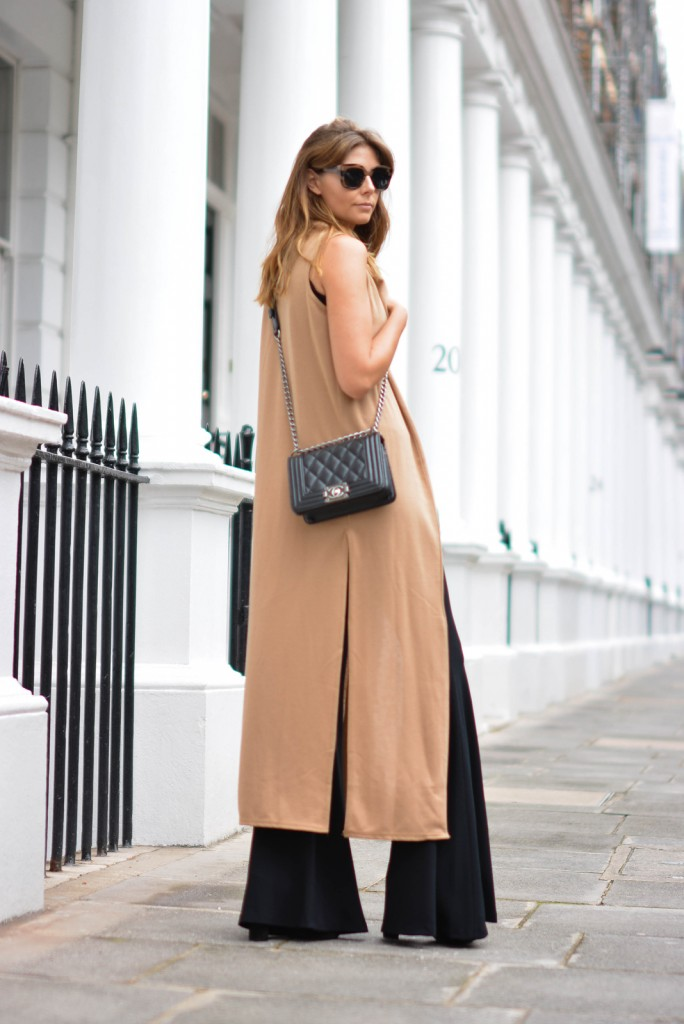 EJSTYLE-wears-boohoo-camel-sleeveless-coat-Zara-black-extreme-flares-Black-small-chanel-boy-bag-wood-effect-chunky-sunglasses-684x1024