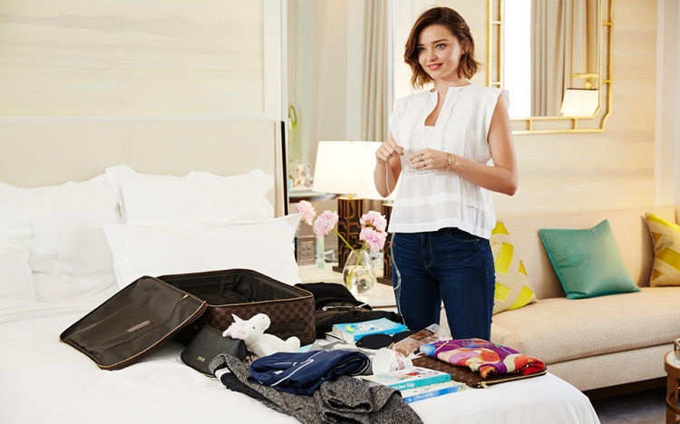 Miranda-Kerr-suitcase-packing-video-BAZAAR